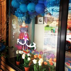 Coco and Charlie Children's Store. Spring window display. Retail.