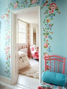 If the blue ************* wall is ******** too dark, just do a STENCIL ****************  or a DECAL  in a less- floral  pattern around the front door ********************