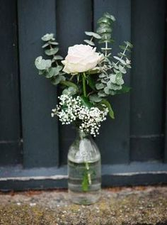 simple wedding centerpiece with eucalyptus, white rose, baby's breath add on the table garland