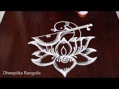 Very easy peacock rangoli by DheepiikaRangolis // आसान रंगोली डिज़ाइन Simple Rangoli Border Designs, Rangoli Designs Peacock, Indian Rangoli Designs, Rangoli Designs Latest, Free Hand Rangoli Design, Rangoli Patterns, Rangoli Ideas, Rangoli Designs With Dots, Beautiful Rangoli Designs