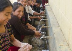 Students from the Canaquil School using the hand washing station