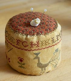 Sampler Pincushion - like the buttons on the pin.