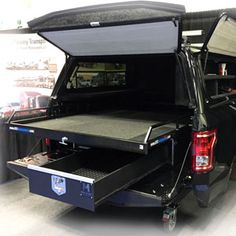 Truck bed storage for your truck! Our truck bed drawers are built to securely store tools, firearms, and equipment for travel. Sliding truck bed drawers also for sale too. Truck Bed Box, Truck Bed Drawers, Truck Bed Slide, Truck Bed Storage, Truck Bed Camping, Truck Boxes, Van Storage, Storage Drawers, Pickup Camping