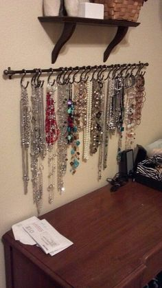 DIY necklace holder…small curtain rod and S-hooks, spray painted black and it would be perfect for hair ties/necklaces. DIY necklace holder…small curtain rod and S-hooks, spray painted black and it would be perfect for hair ties/necklaces. Small Curtain Rods, Small Curtains, Closet Organization, Jewelry Organization, Organization Ideas, Storage Organizers, Plastic Organizer, Organizing Tips, Jewellery Storage