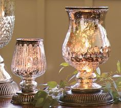 Light filtering through our mercury glass hurricanes has the same warmth as candlelight. Artisans craft each lamp by hand, first blowing the glass into molds, then silvering and antiquing the interior for a timeworn luster.