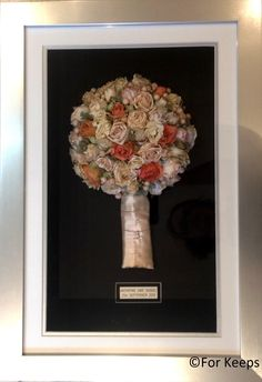 love this pastel coloured bouquet on top of the black, beautiful memoribillia.