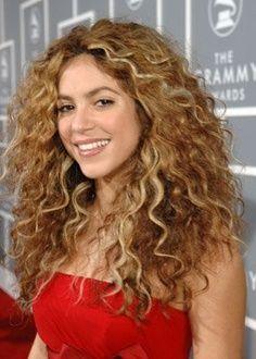Shakira with permed hair