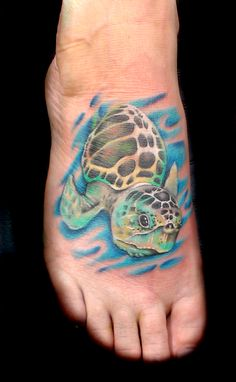 Tattoo by Jojo Miller, Dynamic Ink, Radiant Ink, tattoo placement, tattoo ideas, tattoos for men, tattoos for women, tattoos, turtle, sea turtle, foot tattoo, color, blue, green, yellow, water, ocean, sea, realistic,