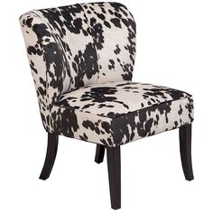 The striking patterned chair adds interest to the (almost) monochrome pallet.