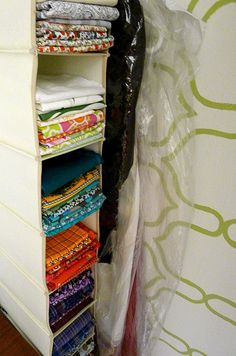 store fabric in a hanging organizer... Genius!