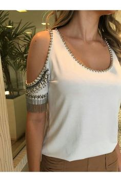 Off the shooter cut out style white bedazzled bling sliver and antique gold sleeve blouse