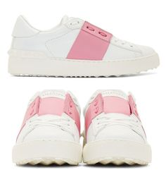 White andd Pink Low Top Sneakers. Buffed leather low-top sneakers in white, round toe, with contrasting panel in bubblegum pink at quarter concealing tonal laces. Gold logo stamp at tongue, rubber pyramid studs at heel counter. Textured rubber sole. Upper leather and rubber sole. http://www.zocko.com/z/JIiap