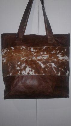 2771b55b33 Handmade genuine leather and Nguni hide bag