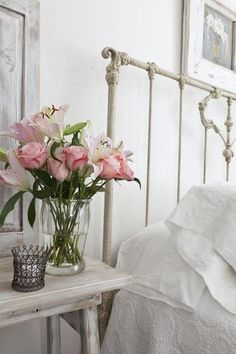 Add a splash of colour through flowers and create warmth in a pale scheme through texture. White interiors. #soft #furnishings. For more inspiration and design advice follow me on Facebook at Maison By Design.