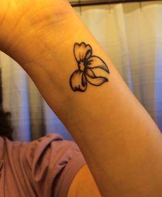 Bow tattoo on wrist.