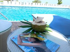 A fresh coconut near the swimming pool of The Rock, Hua Hin. This tastes like nothing else. The Rock, Swimming Pools, Thailand, Coconut, Holidays, Fresh, Table Decorations, Swiming Pool, Pools