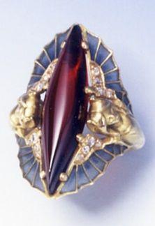 A rare Art Nouveau garnet, diamond, plique-à-jour enamel and gold ring, by René Lalique, circa 1900s.