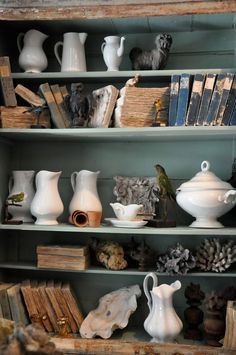 A combination of white pottery, antique books and animal figurines created a display filled with patina!