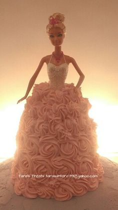 We could make a barbie cake with one of your old barbies if you still have any and put a Ken doll holding on to Barbies hand dressed in a tux :) Isn't that what you always wanted you wedding cake to look like ;)