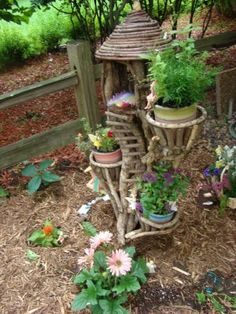 how cute!  I want a little fairy house in our garden :)