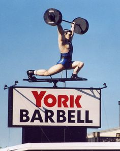 Rotating weightlifter graces the sign for York Barbell alongside I-83 in York Pennsylvania