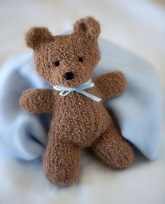 "Free knitting pattern for Harry Bear - Created by the Berroco Design Team, this bear is designed to be used with novelty yarn like fun fur, comes with a scarf pattern, and is 12"" tall. Pictured project is by gammie3 for Primary Children's Hospital in Salt Lake City."