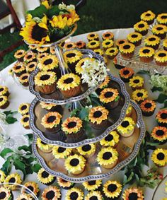 Because Tomas loves sunflowers—and often brings them home for Hilary—the couple thought it would be fun to offer a cheery tower laden with cupcakes frosted with buttercream sunflower florets. Cupcakes by Marie Jackson o Sunflower Wedding Cupcakes, Sunflower Party, Wedding Cakes With Cupcakes, Cupcake Cakes, Sunflower Weddings, Red Sunflower Wedding, Daisy Cupcakes, Cupcake Wedding, Sunflower Bridal Showers