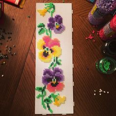Pansies hama perler beads by villal8 - Pattern: https://www.pinterest.com/pin/374291419001893484/