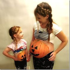 Pumpkin bellies and matching braids - how adorable is this for pregnant mom on Halloween!