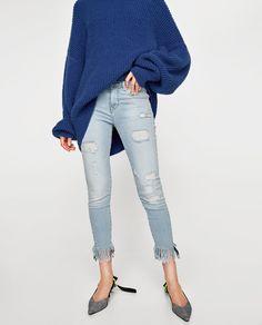 Light blue frayed jeans, size 27 (US 4)