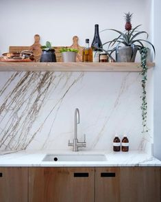 The splashback and worktop in the open-plan kitchen are pink marble