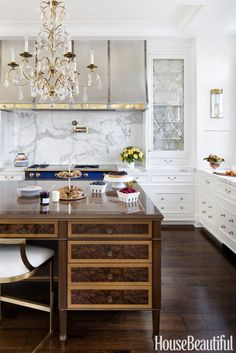 "Wood Island: ""It's nonstop elegance,"" says Richard Anuszkiewicz of the kitchen he created for a circa-1910 waterfront home in Annapolis, Maryland. Click through for more designer kitchens."