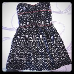 Strapless Summer Dress Black and white Aztec print. Bright coral lined bodice. Skirt isn't lined, but isn't see through. Has pockets at the hip. Stretchy back. Been worn maybe twice. Band of Gypsies Dresses Strapless