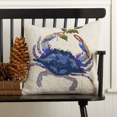 The perfect seasonal addition to your coastal decor, this hooked pillow features a handsome blue crab and mistletoe sprig.