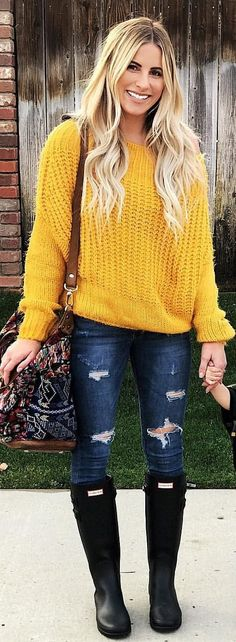 #winter #outfits yellow knitted shirt and distressed blue jeans with black boots