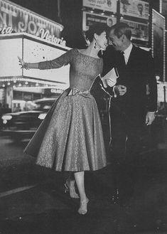 Harper's Bazaar, August 1957. Wearing a cotton lace over taffeta dress by D. Strauss.