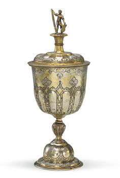 HANS WEINOLD GERMAN SILVER-GILT CUP AND COVER,  embossed chased and engraved with arabesques, fleur-de-lis and gadroons, detachable finial, stem and foot,  Augsburg,  circa 1585-90