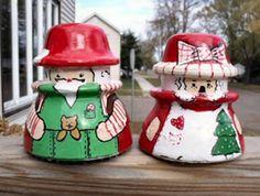 Mr. & Mrs. Santa  painted, antique, telephone insulators