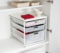 elfa drawer unit solution for the bottom cupboard. Available at Howards Storage World