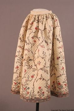 1800-1825   Block printed petticoat with blue and red flowers attached to thin vertical stems set on quilted diamond pattern.  Interior lined with white cotton.