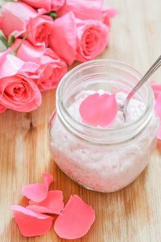 Made with natural sugar, coconut oil, rose essential oil and fresh rose petals, this DIY rose sugar scrub recipe is too pretty to not try!