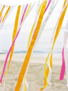 DIY ribbon backdrop...........Tropical beach wedding.....VW Style Shoot | Couture Events Maui | Maui Wedding Planner Photographer: Wendy Laurel....... Florist: Mandy Grace Designs
