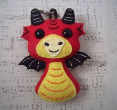 Dragon ear bud holder and key chain in one  keep by HeartFeltPlush