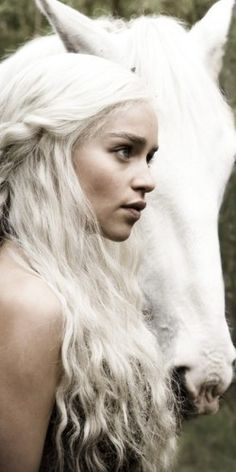white hair with braids and horse. I can't with her she is perfect! Daenerys Targaryen is perfection