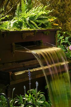 """Repurposed piano fountain. source: Bérénice, flickr  Repurposed piano fountain: I'm almost certain TLC would have included this piano in their """"Waterfall"""" video. It's definitely a work of garden art."""