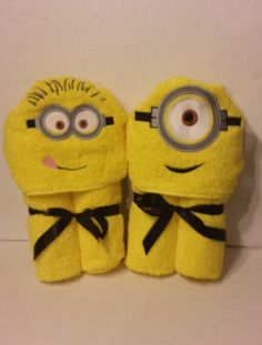 Minion Hooded Towel on Etsy, but these would be easy to make using a small hand towel and a blue bath towel.