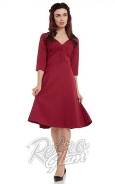 Voodoo Vixen 3/4 sleeve Laura Dress in Red with pleated bust and flare skirt front on model #retroglam #retroglamclothing #pinup #40s #oldhollywood #holiday #dresses #cocktail
