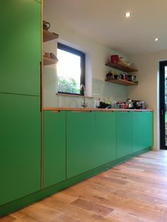 Kitchen - Laminated Plywood, solid Oak, back painted glass