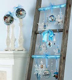 An old ladder mimics the function of a Christmas tree when festooned with ribbon, bows, and pretty ornaments. Decked out in blue and white, this display can last all winter. Simply remove the Christmas-theme ornaments and leave the snowflakes and crystal baubles in place.