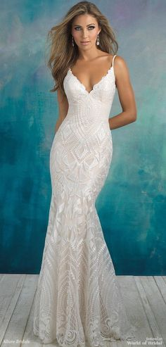 Deconstructed appliques form a geometric pattern over this strappy, slim-fitting gown.
